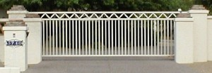 Wrought iron, white automated gate system